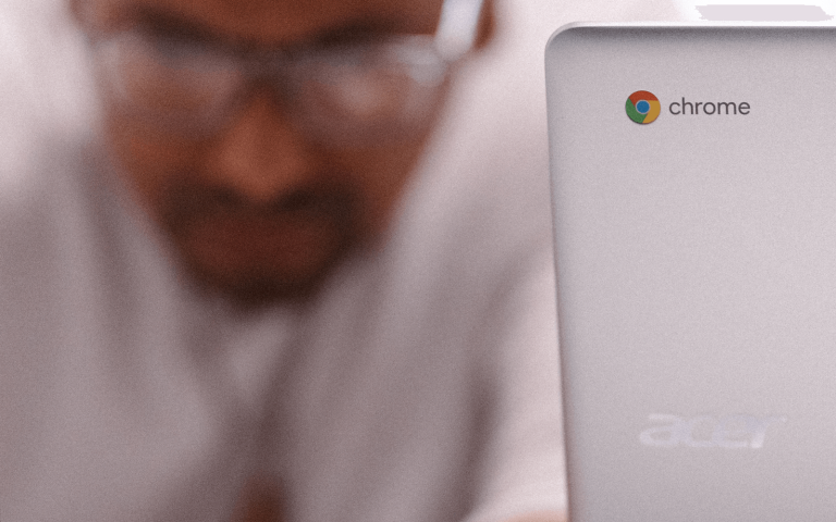 Man working with Chromebook